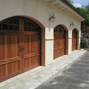 Inspiration for a huge mediterranean attached three-car carport remodel in New York