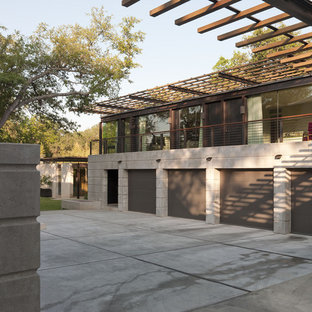 Inspiration for a mid-sized contemporary attached four-car carport in Austin.