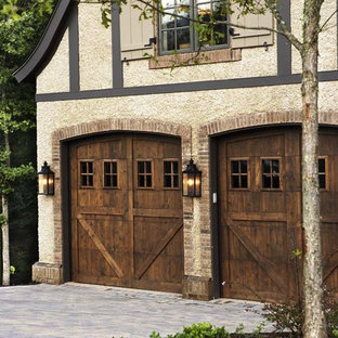 Inspiration for a large rustic attached two-car garage remodel in Other