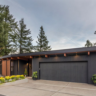 Design ideas for a large midcentury attached garage in Portland.