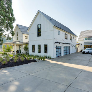 Inspiration for a large cottage attached three-car garage remodel in Portland