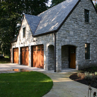 Garage - mid-sized traditional detached three-car garage idea in Other