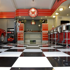 Industrial Garage And Shed by Garage Mahal - Custom Garage Interiors