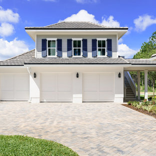 Inspiration for a large beach style detached three-car garage remodel in Jacksonville
