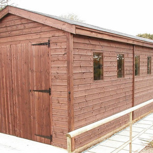 Mid-sized cottage detached two-car carport photo in Sussex