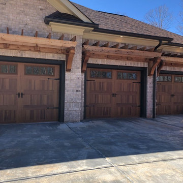 Traditional Custom Home Cedar Garage Doors Pergola