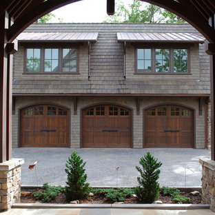 Example of a mid-sized classic detached three-car porte cochere design in Other