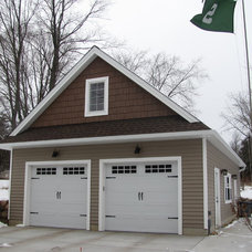 Traditional Garage And Shed by Momentum Construction LLC