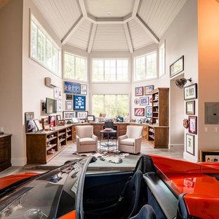 Inspiration for a huge transitional attached two-car garage workshop remodel in Houston