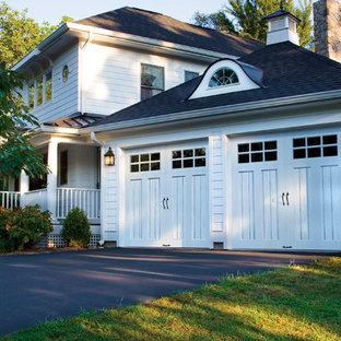 Large elegant attached two-car garage photo in Philadelphia