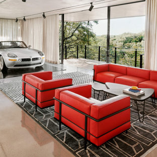 Example of a huge trendy detached three-car garage design in Austin