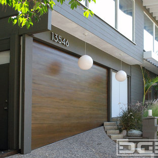 Design ideas for a large modern attached double garage in Los Angeles.