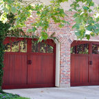 Wood carriage house doors and heritage mica stone veneer for Wood veneer garage doors