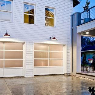 Garage workshop - huge modern detached two-car garage workshop idea in Orlando