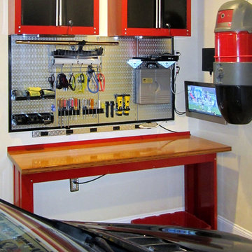 Wall Control Metallic Pegboard Over a Workbench with Custom Framing