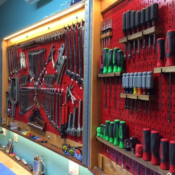 Wall Control Red Metal Pegboard Built Into Folding Cabinet Doors