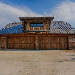 Example of a mountain style detached four-car garage design in Other