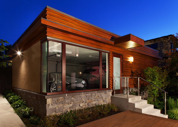 Contemporary Garage by John Henshaw Architect Inc.