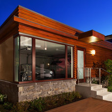 Contemporary Garage And Shed by John Henshaw Architect Inc.