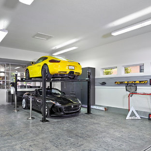 This is an example of a large contemporary attached three-car workshop in Edmonton.