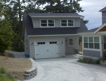 With the new facade and detached garage.