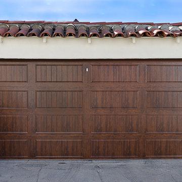 Wood gates and matching garage door