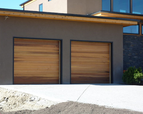 Photo Of A Mid Sized Modern Attached Two Car Carport In Calgary.
