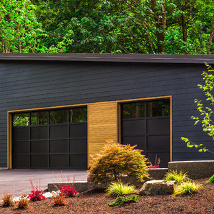 Example of a trendy attached three-car garage design in Seattle