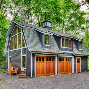 Garage workshop - cottage detached two-car garage workshop idea in New York