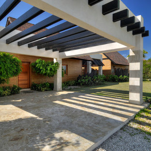 Inspiration for a mid-sized tropical detached two-car carport in Other.