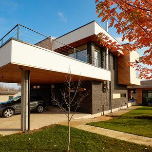 Стильный дизайн: гараж в современном стиле с навесом для автомобилей для двух машин - последний тренд