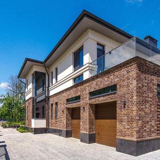 Пример оригинального дизайна: пристроенный гараж в современном стиле для двух машин