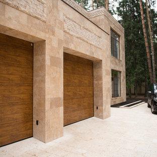 На фото: гараж в современном стиле для двух машин