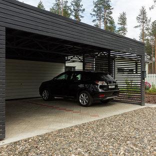 Пример оригинального дизайна: отдельно стоящий гараж в современном стиле с навесом для автомобилей для двух машин