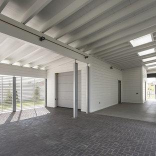 Пример оригинального дизайна интерьера: гараж среднего размера в современном стиле