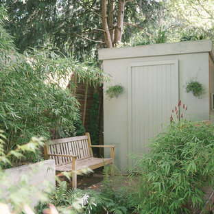 This is an example of a medium sized modern detached garden shed in London.