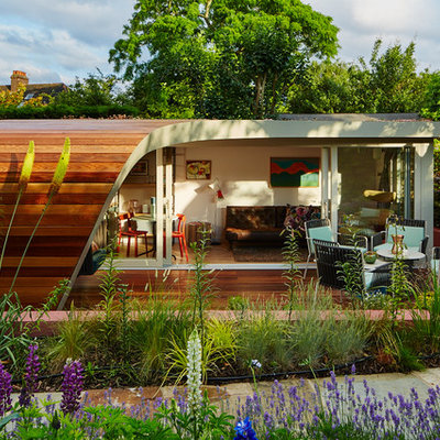 Eclectic detached garden shed photo in London