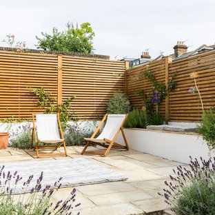 Photo of a mid-sized transitional detached garden shed in London.