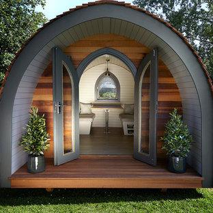 Idées déco pour un petit abri de jardin séparé éclectique.
