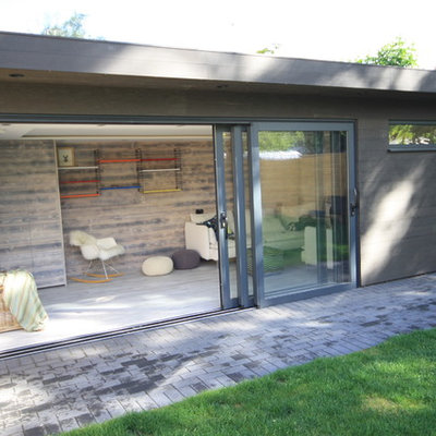 Inspiration for a mid-sized contemporary detached studio / workshop shed remodel in Surrey