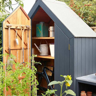This is an example of a transitional detached garden shed in London.