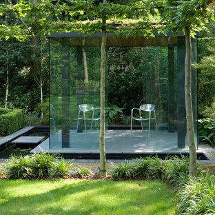 Photo of a small contemporary detached garden shed and building in London.