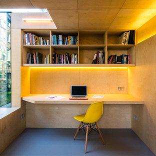 Aménagement d'un abri de jardin contemporain avec un bureau, studio ou atelier.