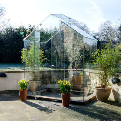 Greenhouse - small contemporary detached greenhouse idea in Other