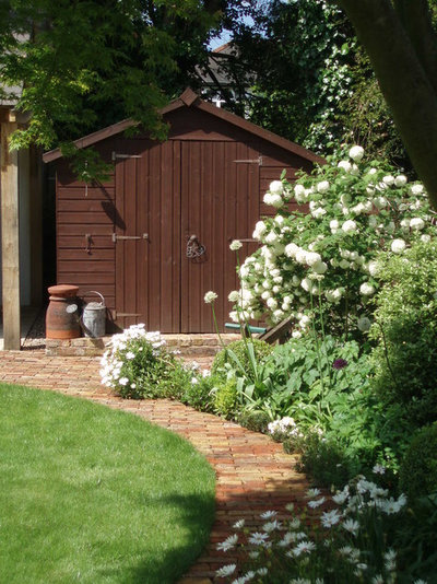 Traditional Shed by Joanne Winn Garden Design