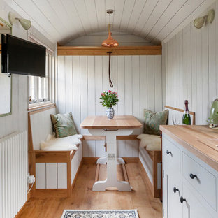Example of a small cottage chic guesthouse design in Other