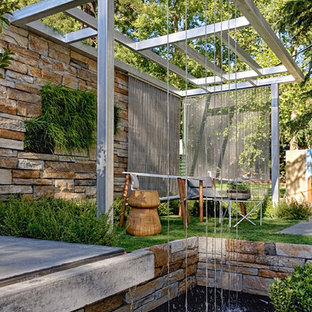 Design ideas for a contemporary garden in Melbourne with a water feature.