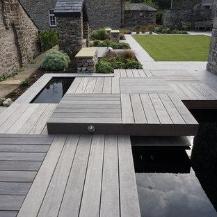 Inspiration pour un jardin à la française avant design de taille moyenne et l'été avec une exposition ensoleillée et des pavés en pierre naturelle.