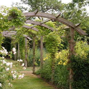 Design ideas for a classic formal garden in Sussex with a garden path.