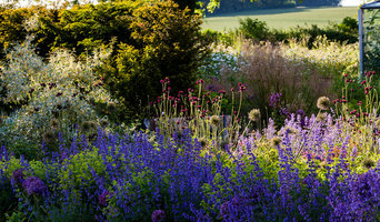 A garden of woodland, meadow, lawn and rich planting
